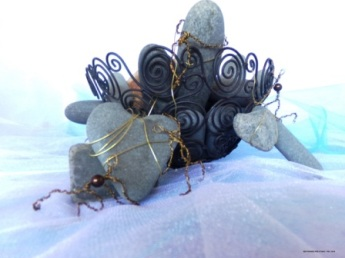 Restrained Pre-Stain II - Rocks, wire basket and skeleton (found objects), along with original wire people