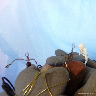 Restrained Pre-Stain IX - Rocks, wire basket and skeleton (found objects), along with original wire people